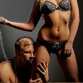 man on leash worshipping woman in lingerie